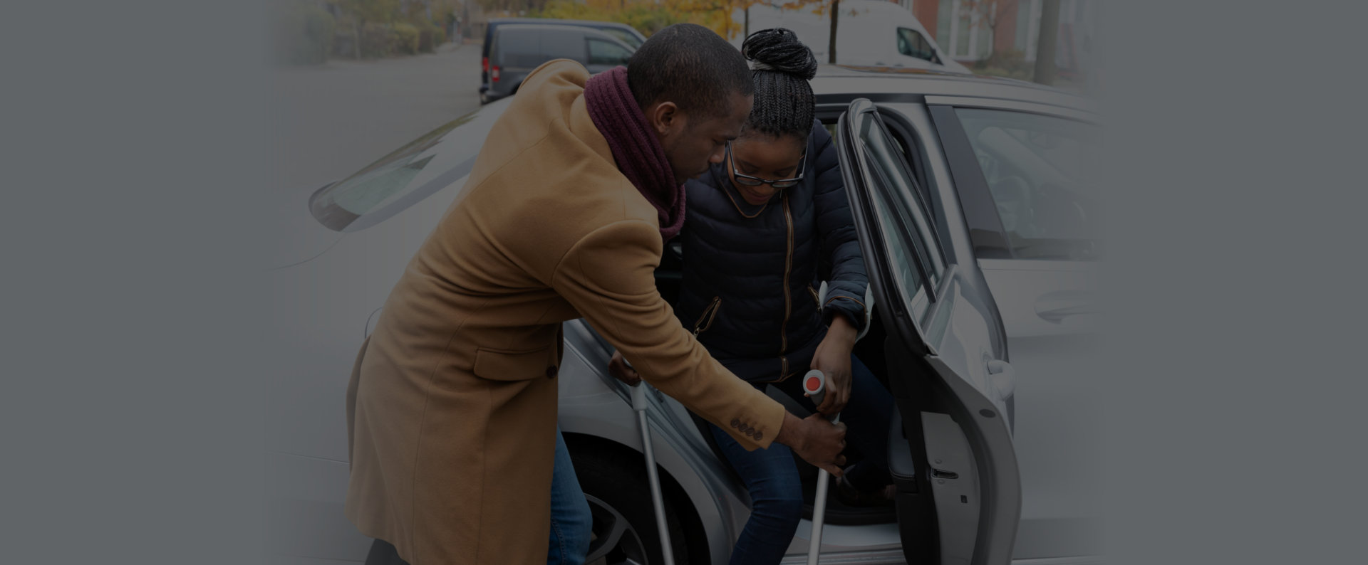 man assisting woman in the car