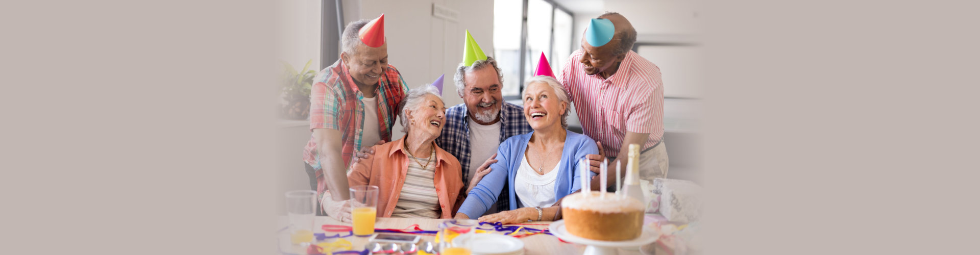 excited senior woman during birthday party in nursing home