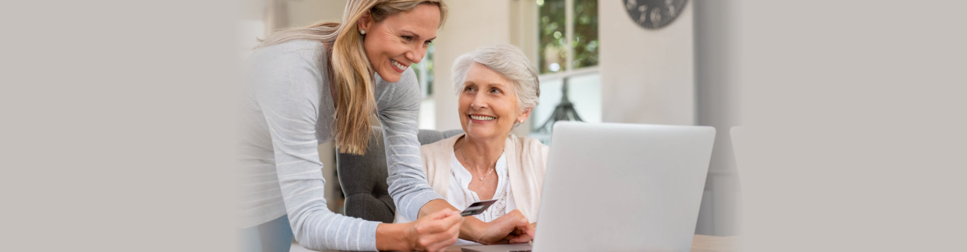 mother and daughter buying online.